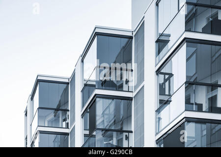 Abstract fragment of contemporary architecture, walls made of glass and concrete. Blue tonal filter photo effect - Stock Photo