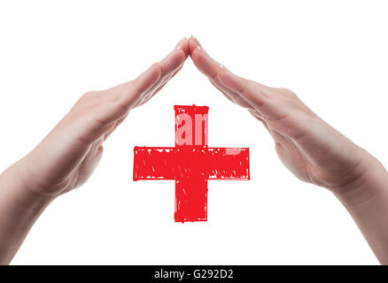 White female hands acting as a roof and protecting the red cross sign. Health insurance concept isolated on white - Stock Photo