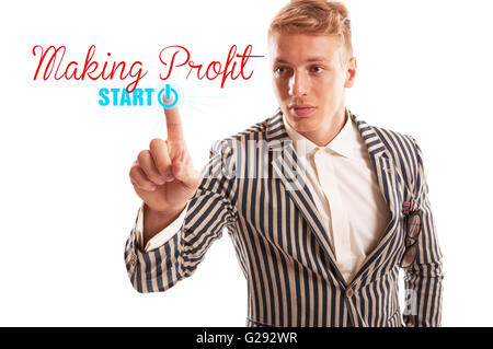 Start making profit concept using a man pressing the start button undet the making profit text. Isolated on white - Stock Photo
