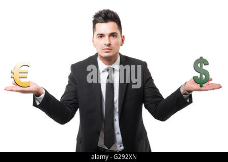 Business man holding euro and dollar symbols or signs. Euro versus dollar concept isolated on white background - Stock Photo