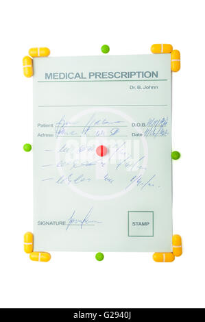 Medical prescription with yellow pills around the corners and a red pill in the center of it - Stock Photo