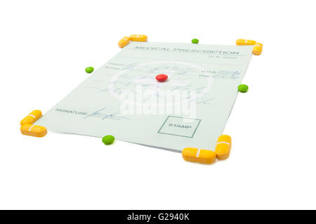 Medical prescription with yellow pills around the corners and a red pill in the center of it, the object is isolated - Stock Photo