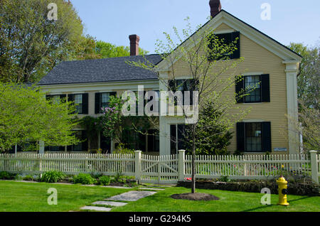 Yellow clapboard historical house in spring, Yarmouth, ME, USA - Stock Photo