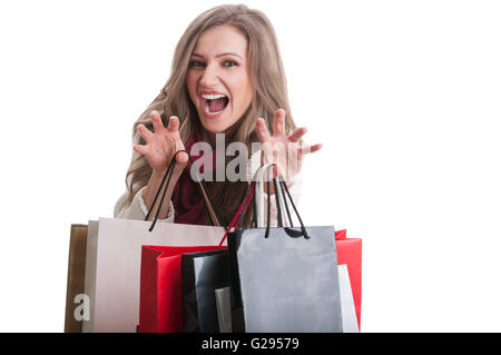 Shopping girl acting like a cat while holding shopping bags - Stock Photo