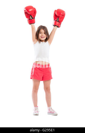 Young boxer girl champion raising arms up in the air isolated on white background - Stock Photo