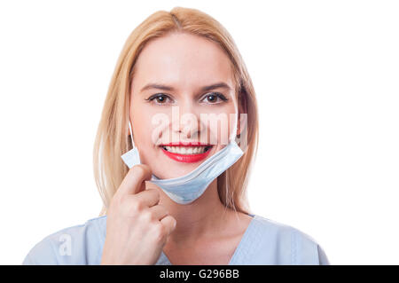 Beautiful and friendly female doctor smiling isolated on white background - Stock Photo