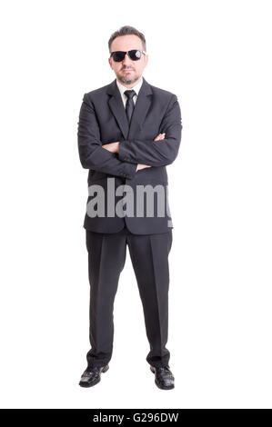 Business man or sales man wearing black suit and sunglasses or shades - Stock Photo