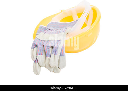 Builder yellow hat and leather gloves isolated on white studio background - Stock Photo