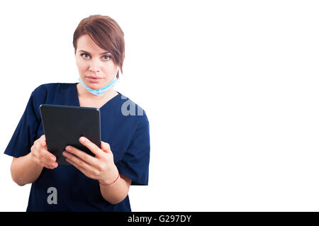 Beautiful female doctor using tablet isolated on white copyspace - Stock Photo
