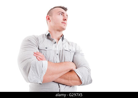 Hero shot in low angle of man or male model with arms crossed wearing shirt on white background - Stock Photo