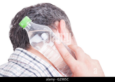 Man cooling back of the neck using cold water plastic bottle - Stock Photo