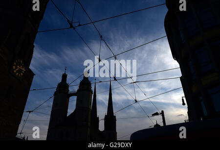 The aerial lines of the local tram spans across the market square near the 'Marktkirche', the market square church - Stock Photo