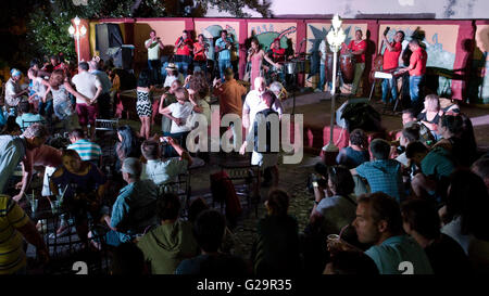 Cuban musicians in a group playing and singing salsa for locals and tourists at the Casa de la Músíca in Trinidad, - Stock Photo
