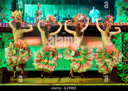High ISO and slow shutter speed due to low light so some motion blur.  The music of Cuba, including its instruments, - Stock Photo