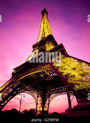 Low angle of the Eiffel Tower at dusk - Stock Photo