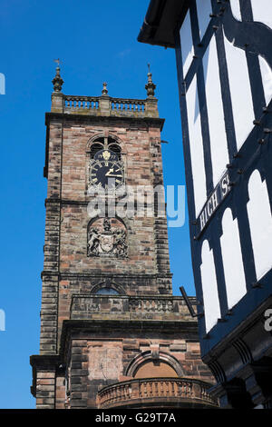 St Alkmund's Church and a half-timbered building in High Street,Whitchurch, North Shropshire, England, UK - Stock Photo