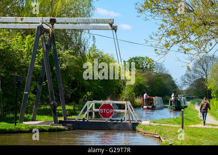 Two canal boats at Morris's Bridge on the Llangollen Canal at Whixall Moss, north Shropshire, England, UK - Stock Photo