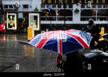 GREAT BRITAIN, London, Notting Hill, pedestrian with umbrella with Union Jack flag during London rain - Stock Photo