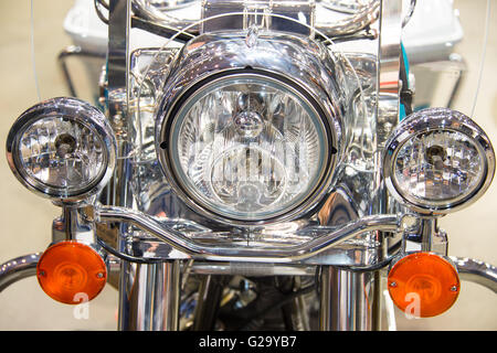 Close-up view of motorcycle headlight - Stock Photo