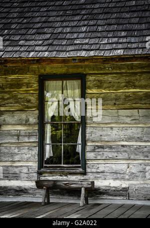 ... A Window With Drawn Back Curtains On A Charming Rustic Log Cabin With  Front Porch And