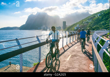 RIO DE JANEIRO - MARCH 19, 2016: Cyclists ride along the newly completed Ciclovia Tim Maia bike path, an Olympic - Stock Photo