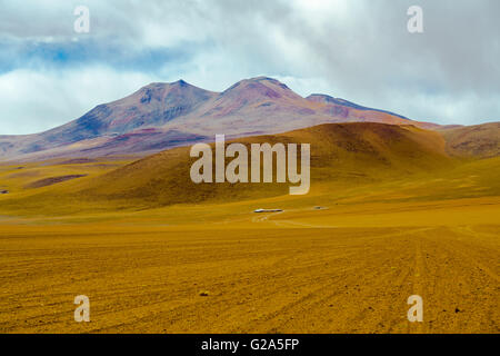 View of mountain and desert in Salar de Uyuni, Bolivia - Stock Photo