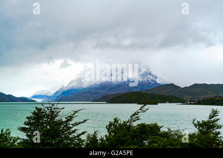 View of Gray Lake and Gray Glacier with the snow mountain in rainy day, Patagonia, Chile - Stock Photo