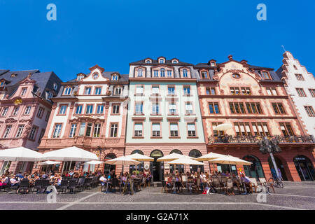 Cafes, restaurants and town houses at the market place, downtown, Mainz, Rhineland-Palatinate, Germany - Stock Photo