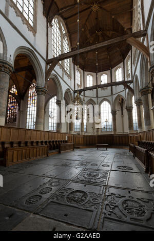 Interior of Oude Kerk, Amsterdam, showing stone floor, choir stalls and altar. - Stock Photo