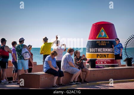 Tourists photographing themselves at the Marker at the Southernmost Point in America, Key West, Florida, USA - Stock Photo
