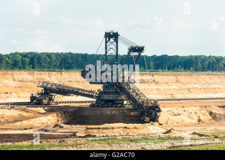 Bucket-wheel excavator digging lignite (brown-coal) - Stock Photo