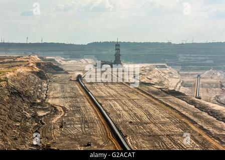 Large machinery at work in a lignite (browncoal) mine - Stock Photo