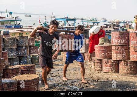 Workers on the beach of Mandalay. with loads , Mandalay, Myanmar, Burma, South Asia, Asia - Stock Photo