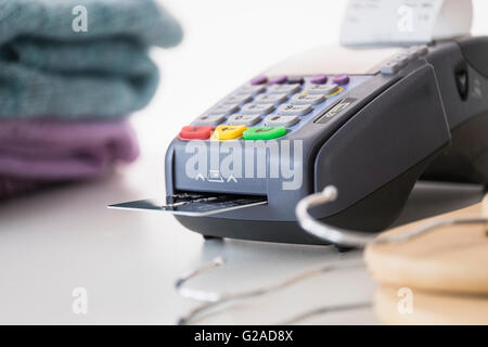 Credit card reader on counter - Stock Photo