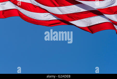 American flag against blue sky - Stock Photo