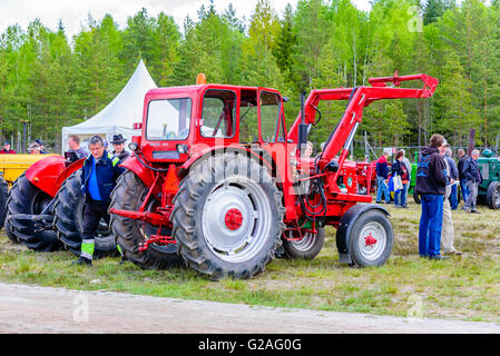 Emmaboda, Sweden - May 14, 2016: Forest and tractor (Skog och traktor) fair. People looking at vintage classic tractors. - Stock Photo