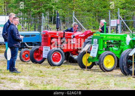 Emmaboda, Sweden - May 14, 2016: Forest and tractor (Skog och traktor) fair. People looking at classic vintage tractors, - Stock Photo