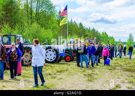 Emmaboda, Sweden - May 14, 2016: Forest and tractor (Skog och traktor) fair. People looking at classic vintage tractors. - Stock Photo