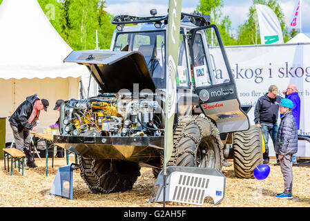 Emmaboda, Sweden - May 14, 2016: Forest and tractor (Skog och traktor) fair. Malwa forwarder with open hood and - Stock Photo