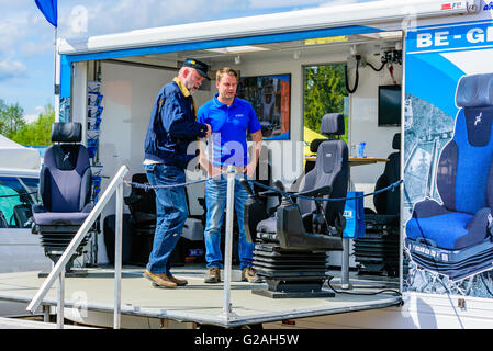 Emmaboda, Sweden - May 14, 2016: Forest and tractor (Skog och traktor) fair. Salesperson and visitor looking at - Stock Photo