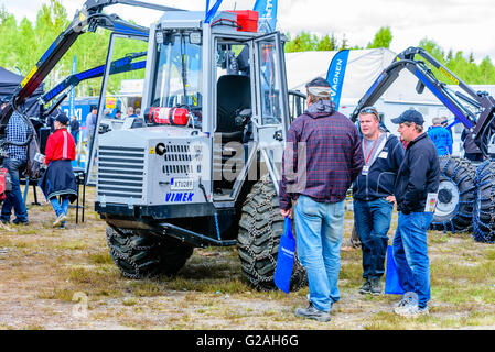 Emmaboda, Sweden - May 14, 2016: Forest and tractor (Skog och traktor) fair. Salesperson talking to visitors about - Stock Photo