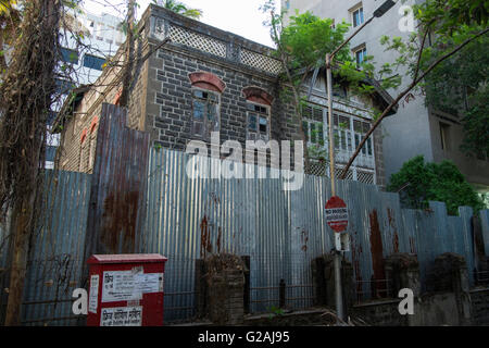 An old heritage building is marked for demolition in Pune, as real estate boom starts eating up the old parts of - Stock Photo