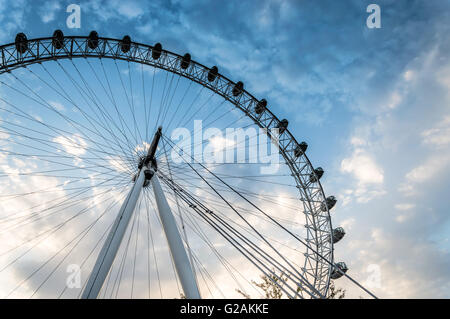 LONDON, UK - AUGUST 23, 2015: London Eye low angle view a cloudy day near sunset - Stock Photo