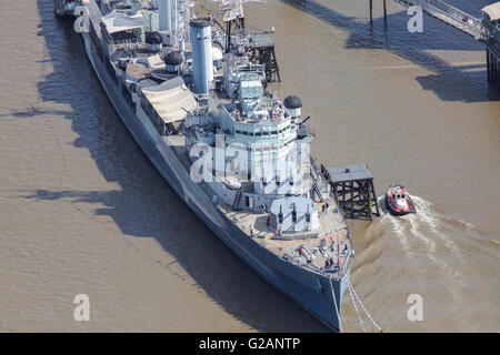 An aerial view of HMS Belfast a former Royal Navy light cruiser and now a London tourist attraction - Stock Photo