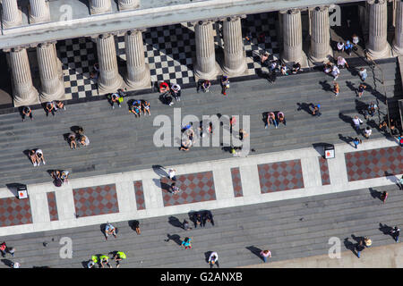 A close up aerial view of people sitting on the steps of St Pauls Cathedral - Stock Photo
