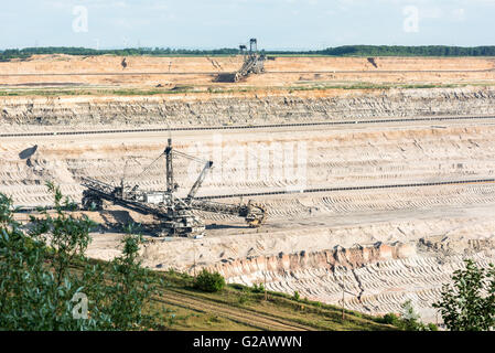 Hambach, Germany - May 19, 2016: One of the world's largest bucket-wheel excavators is digging lignite (brown-coal) - Stock Photo
