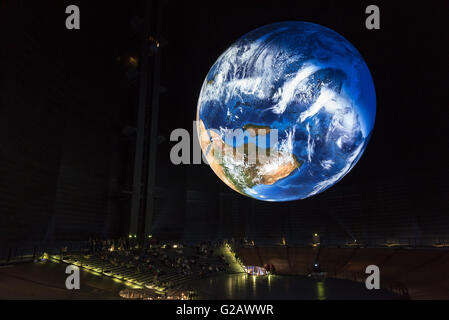 Oberhausen, Germany - May 21, 2016: A large earth with a diameter of 20 metres is floating above the visitors of - Stock Photo