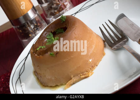 A classic English dish of Steak and Kidney Suet Pudding ...