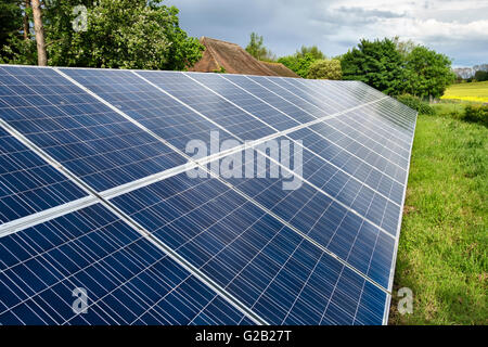 A Photo Voltaic Solar Panel Installation On A Domestic