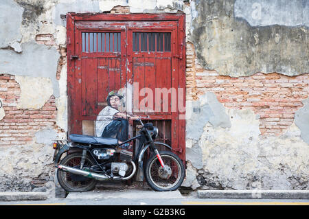 GEORGE TOWN, MALAYSIA - MARCH 22: 'Boy on Motorcycle' street installation from Ernest Zacharevic on March 22, 2016 - Stock Photo